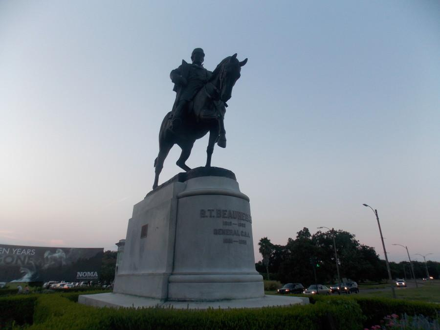 The monument of P.G.T. Beauregard, a Confederate general, is perched at the entrance of City Park. The monument is one of four in New Orleans dedicated to the Civil War period considered for removal after a national conversation about racism and Confederate symbolism was ignited by the murders of 9 people in the church shooting in Charleston, SC in June 2015. Photo credit: Rodriana Edwards