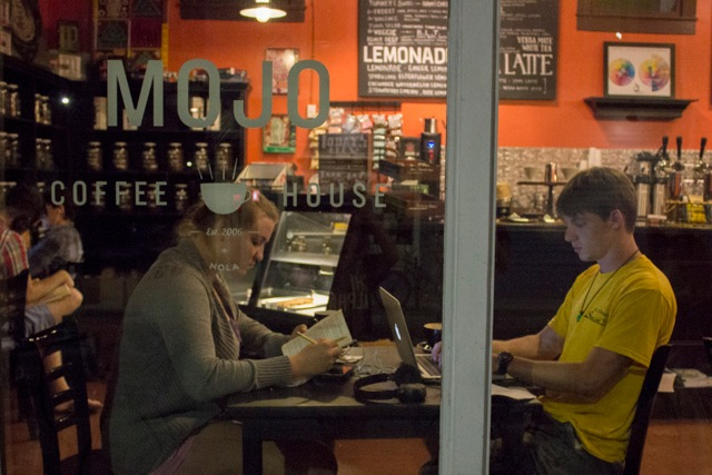 atilyn Woltz and Dillon Tauzin, Loyola seniors, enjoy drinks while studying. They represent the growing trend of frequenting coffee shops.