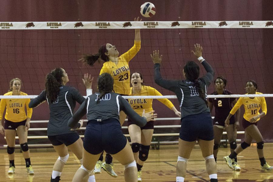 Maddie Heukels, english freshman, goes for a spike in a game against Alcorn State on Wednesday, Sept. 9. The Pack will hit the road on Friday, Sept. 18 to take on Coastal Georgia, which is the number two team in their respective conference. Photo credit: Zach Brien