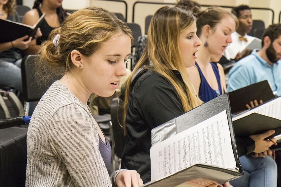"Marinna Carmichael, vocal performance junior, Alexandra Mena, music junior, and Audrey Harmon, music performance junior, practice with Loyola's chamber choir. The choir will perform at the upcoming opera ""Wading Home: An Opera of New Orleans."""