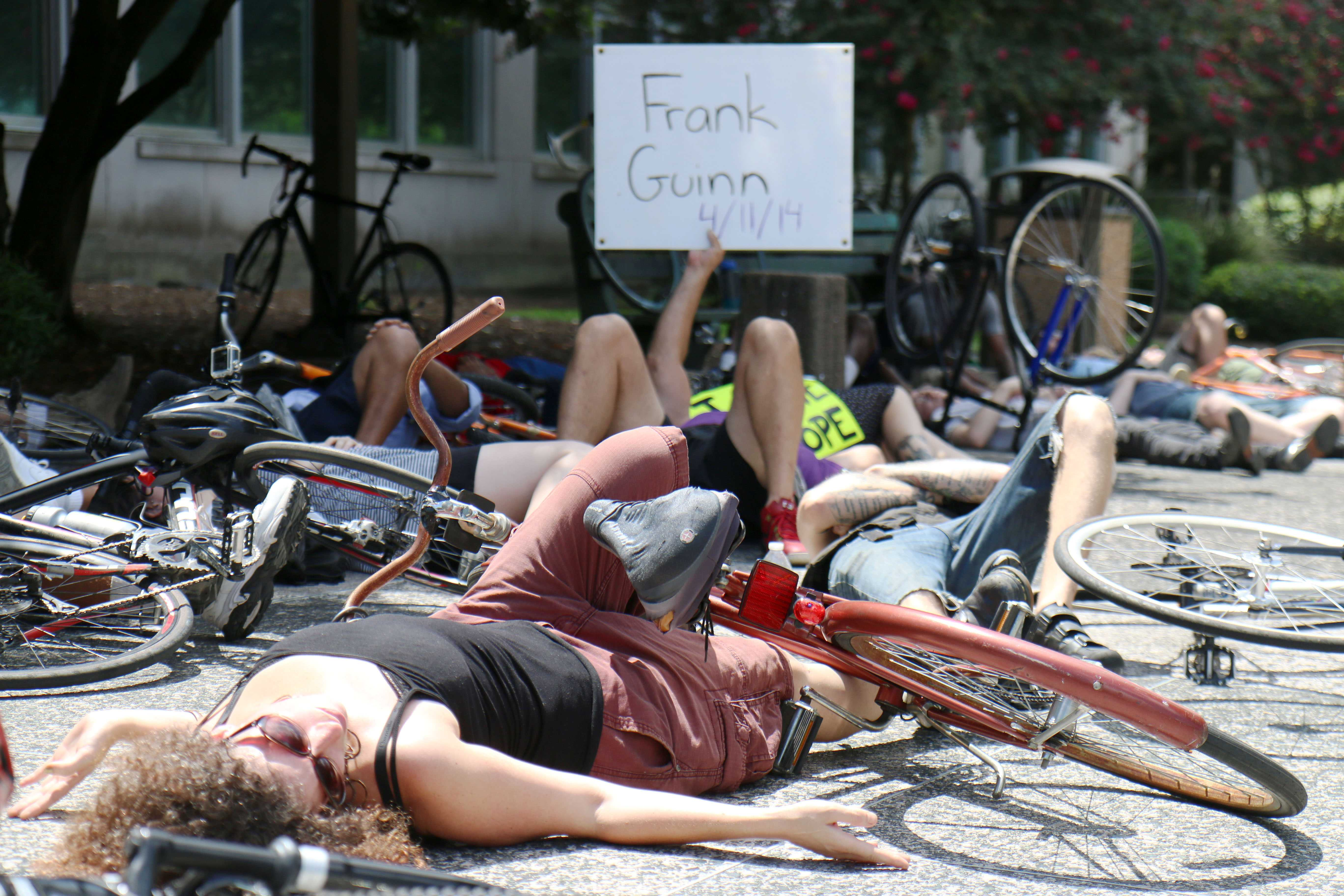 Cyclists prostrate themselves in front of City Hall as part of a die-in protest on July 23. This protest was part of a call for bicycle-friendly laws and infrastructure in the city of New Orleans and an overall awareness of cyclists' rights on the road.