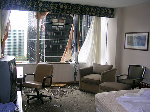 His hotel room window, made of crystal glass, exploded after the storm made landfall with 127 mph winds.