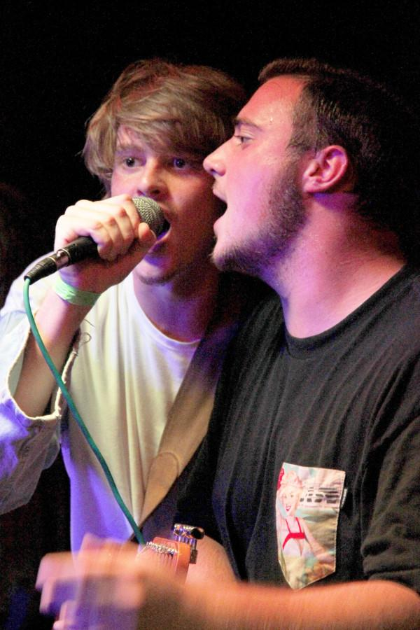 Ian White, left, of Chopped Up Tulips, sings with Austin Morr, right, of Unlyke Most at the Willow Bar. Chopped Up Tulips and Unlyke Most are two of several bands benefiting from opportunities at Loyola.