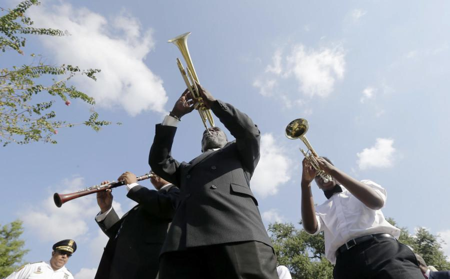 Musicians lead a procession during a wreath laying ceremony at the Hurricane Katrina Memorial on the 10th anniversary of Hurricane Katrina in New Orleans on Saturday, Aug. 29, 2015. Events were held citywide to commemorate Katrina. (AP Photo/Gerald Herbert)