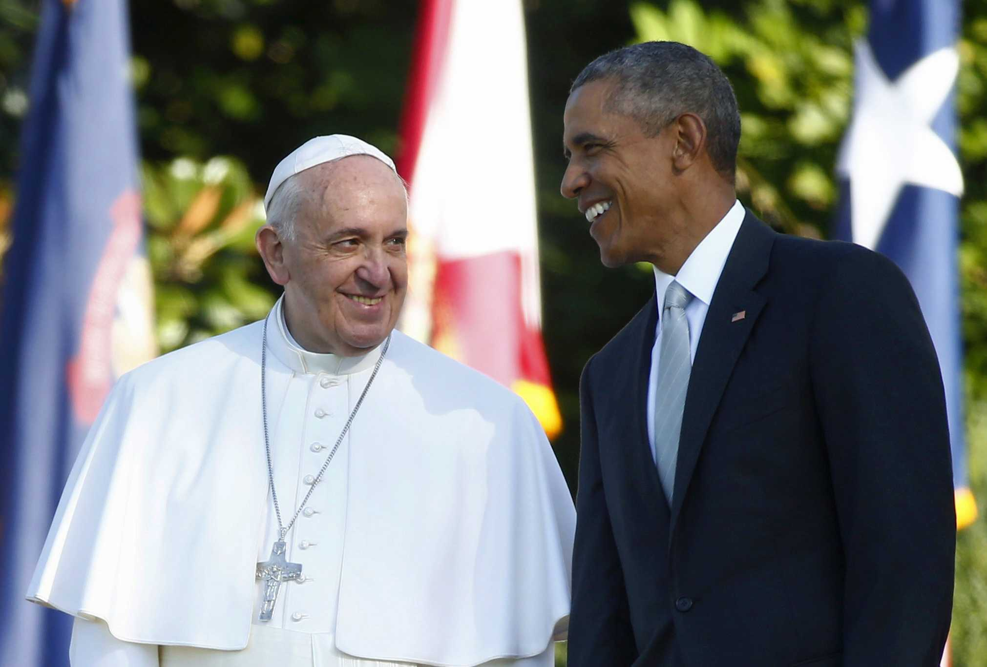 President Barack Obama talks with Pope Francis during a state arrival ceremony on the South Lawn of the White House in Washington, Wednesday, Sept. 23. The Pope will depart for Rome on Sept. 27. (Tony Gentile/Pool Photo via AP)