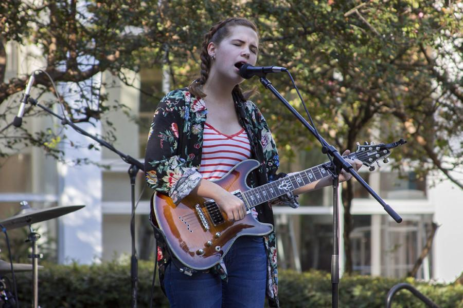Lydia Kolda of Squirrel Queen rock performs at Third Friday.