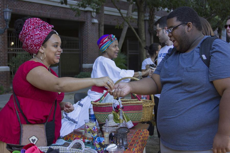 JeBari Lewis, communications sophomore, gets his fortune read at Third Friday on Oct.16t. This months theme was Freaky Friday, and it featured palm readings and making personal gris gris bags. Photo credit: Taylor Galmiche