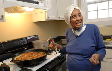 FILE - In this March 4, 2007, file photo, Willie Mae Seaton cooks fried chicken for volunteers helping to rebuild her Hurricane Katrina-devastated restaurant, Willie Mae's Scotch House, in New Orleans. Seaton, a chef recognized for her classic American food and whose neighborhood restaurant helped put fried chicken on the culinary map, has died at 99. (AP Photo/Cheryl Gerber, File)