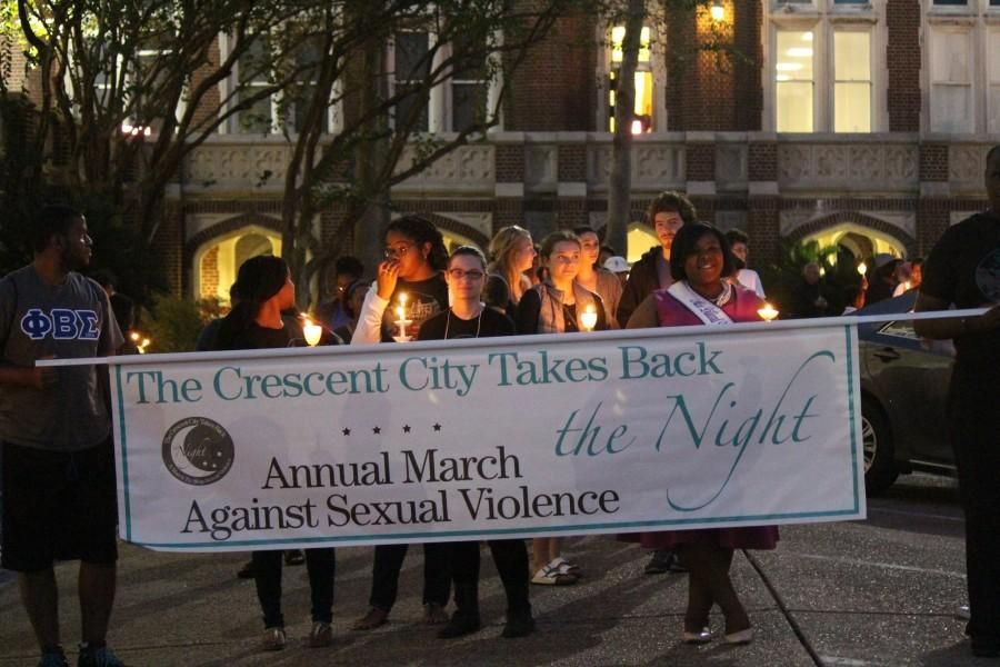Students+prepare+to+march+at+Take+Back+the+Night+in+the+horseshoe.+The+event+brings+together+students+from+Loyola%2C+Tulane%2C+Xavier+and+Dillard+to+call+attention+to+sexual+assault.+Photo+credit%3A+Kristen+Stewart