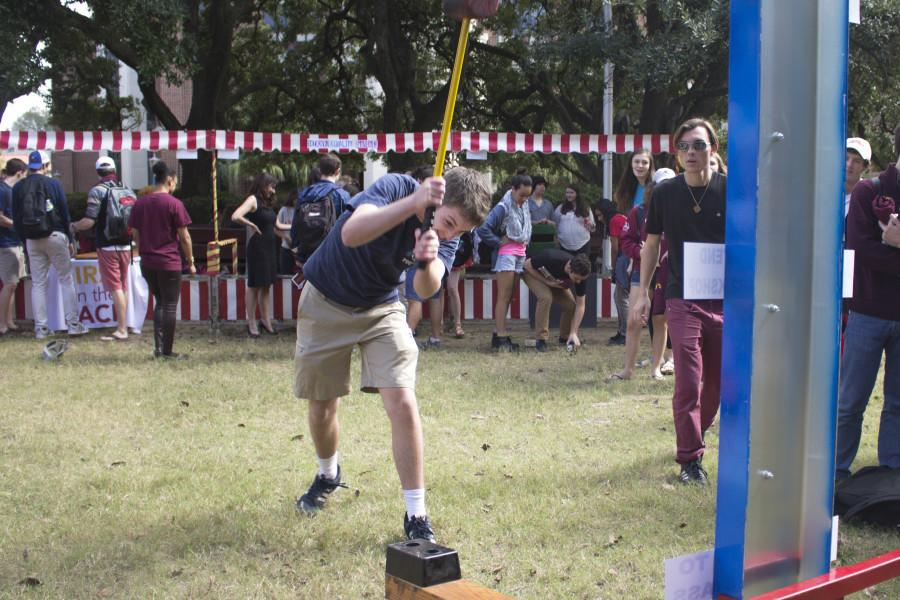 Philip Reidy, mass communication junior, tests his strength at Iggy Fest in the Peace Quad as part of Loyola Week. Iggy Fest was one of many daily activities during the Loyola Week, which took place from Nov. 1 to Nov. 6. Photo credit: Kristen Stewart