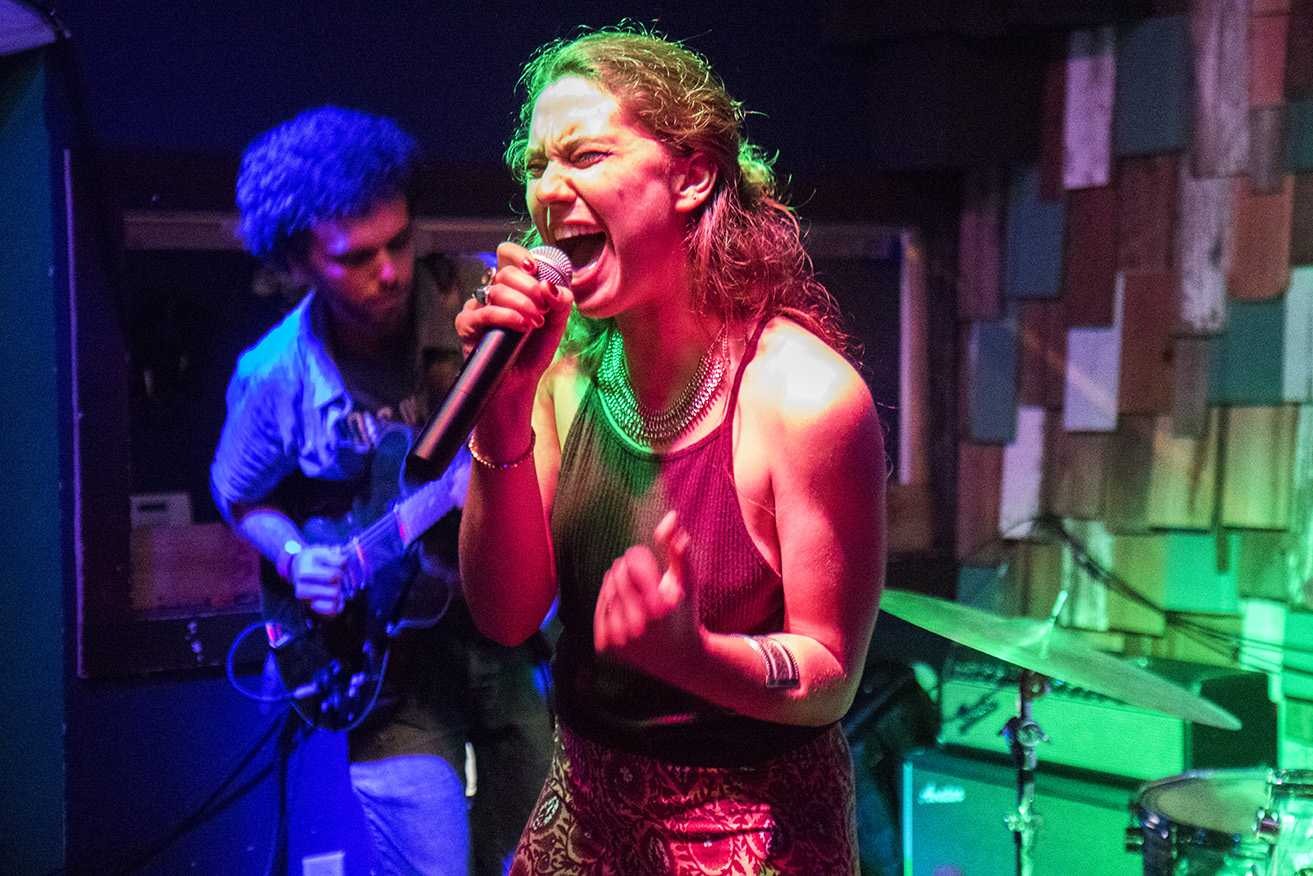 Abby Diamond, music industry studies senior, performs at Gasa Gasa in the first installment of the Feminista concert series.  The show, which featured three other female performers, was intended to highlight female musicians in New Orleans.