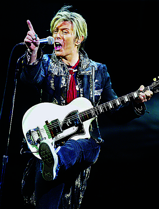 Lengendary 70's British rock star David Bowie performs in concert on Jan. 31, 2004 at the Shrine Stadium in Los Angeles. (Ken Hively/Los Angeles Times/TNS)