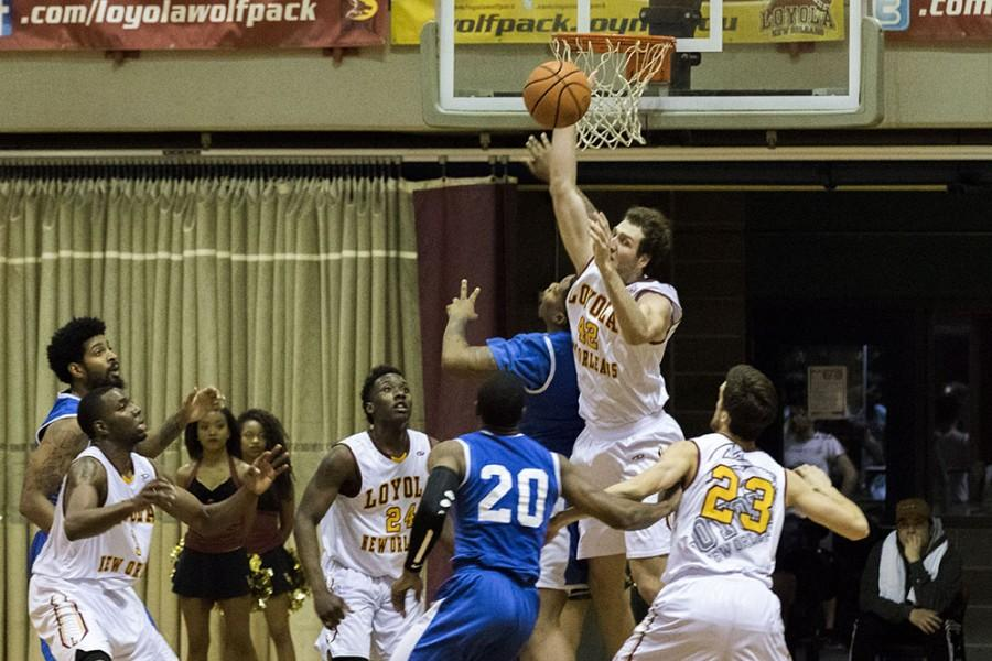 Nate Pierre, Loyola junior guard, blocks a shot against Dillard University in the Den on February 2, 2016. The Wolf Pack beat no. 21 Dillard University 82-65 thanks to a stout defense and double-digit scoring totals by Johnny Griffin Jr., Nick Parker and Tre'Von Jasmine.