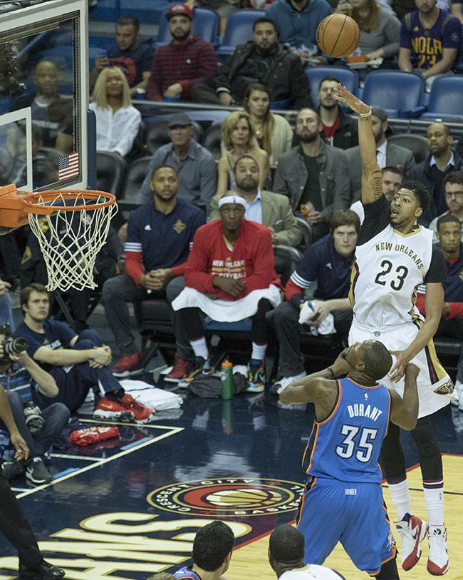 Anthony Davis, Pelicans' forward, right, shoots a jump shot over Thunder forward Kevin Durant during the second half of their game on Thursday, February 25 in the Smoothie King Center. The Pelicans won the matchup 123-119, bringing their record to 23-34.