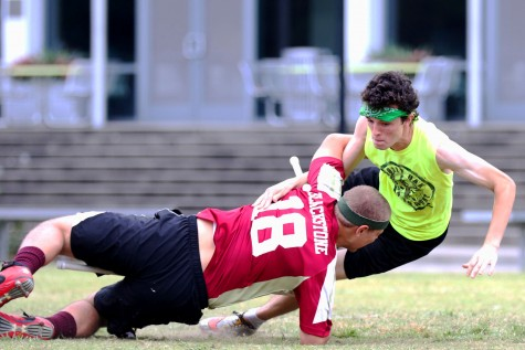 Oliver Blackstone, Loyola keeper, tackles Andrew Brekus, Gulf Coast Gumbeaux chaser, at Crawfish Cup at Tulane University on Oct. 10, 2015. The quidditch team's next tournament is the Consolation Cup, which will be held on April 2. Photo credit: Zach Brien