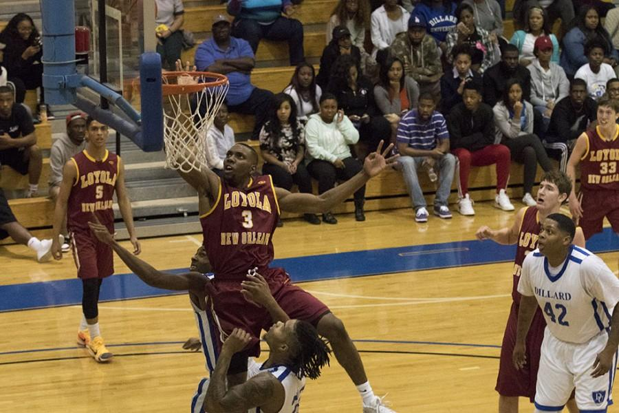 Johnny+Griffin+Jr.%2C+Loyola+junior+guard%2C+puts+back+a+missed+shot+by+guard+Tre%27Von+Jasmine+in+the+first+half+of+their+game+at+Dillard+University.+Griffin+finished+with+10+points+in+a+93-80+loss+to+Dillard.