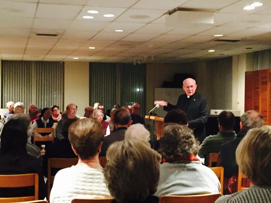 Fr.+Fred+Kammer+S.J.+reads+from+Pope+Francis%27s+Evangelii+Gaudium+%28The+Joy+of+the+Gospel%29+in+the+Ignatius+Chapel.+The+first+of+an+on+campus+lenten+series+focusing+on+Pope+Francis%27+spirituality+was+titled+The+Joy+of+the+Gospel.+Photo+credit%3A+Caleb+Beck