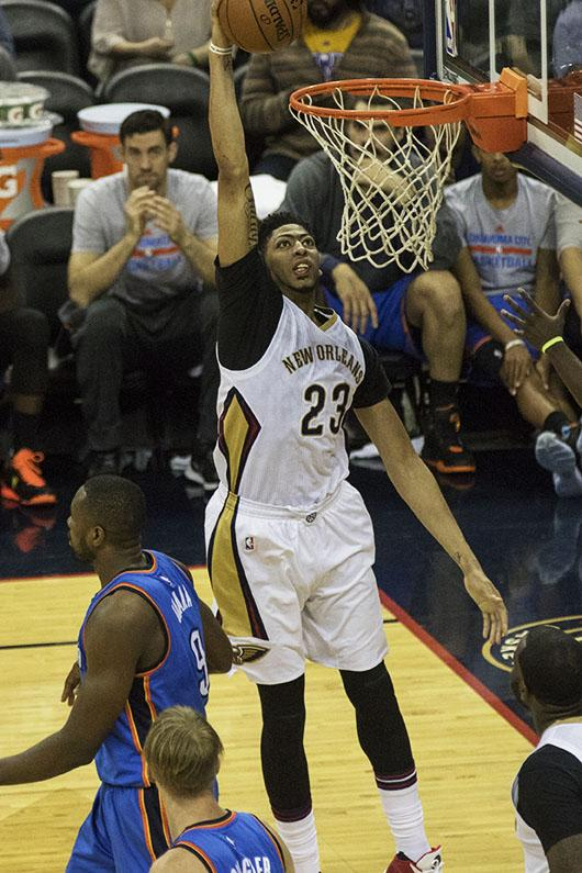 Anthony Davis dunks the ball against the Oklahoma City Thunder on Feb. 25. Davis is averaging 24 points while the Pelicans have a 23-35 record on the season. Photo credit: Zach Brien