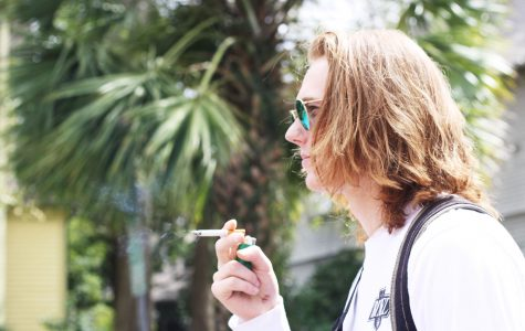 Leo Kwiatkowski, music industry business sophomore, smokes off campus. The smoking ban's grace period ended in February 2016, after the smoking ban went into effect in August 2015.