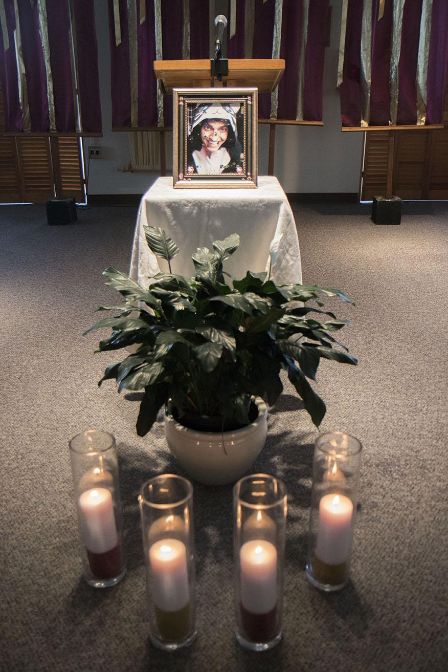 A picture of Juliano Mastroianni, an international business sophomore, was placed at the podium, behind four candles dedicated to the students and faculty members who died this semester, during the memorial for Mastroianni in Ignatius Chapel. Mastroianni was found dead in his Cabra Hall dorm room on April 14.