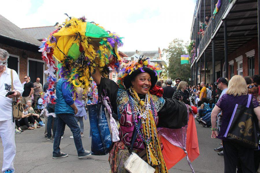 """Jennifer Jones, a local tour guide also known as the """"The Dance Lady,"""" struts through the busy streets of New Orleans for tips. Even with the stigma of crime, New Orleans is a still a prime spot for tourists to visit throughout the year."""