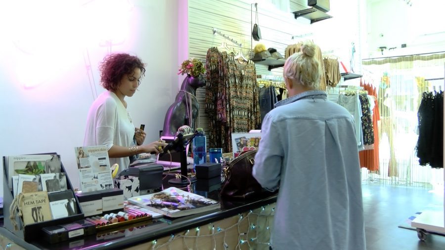 Kay Charbonnet makes a sale at her boutique, Kay's. Charbonnet is one of the many small business owners who are  worried about their businesses being negatively affected by the new sales tax increase, which was put into effect on April 1.