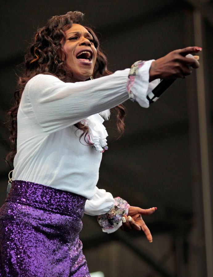 Big Freedia holds the microphone out to the crowd during her performance on the Congo Square Stage during day 6 of Jazz Fest at the Fair Grounds in New Orleans, Saturday, April 30, 2016. (Sherri Miller/The New Orleans Advocate via AP)