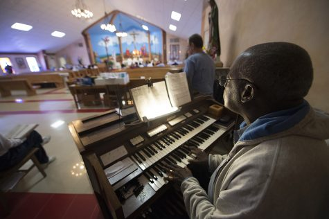 Angola inmates lead music at a mass in the prison's Our Lady of Guadalupe Chapel April 29.  The mass included the graduation of six inmates from the Loyola Institute for Ministry's extension program with certificates in pastoral studies.