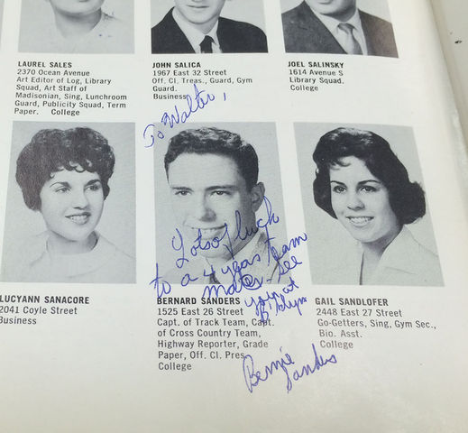 Nick Reimann/The Maroon  Walter Block shows his yearbook from James Madison High School in 1959. Pictured is a signature and message from his track teammate, Bernie Sanders.