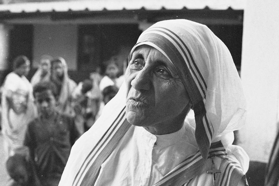 Mother Teresa stands outside her Home for the Dying Destitutes in Kolkata, India, on March 30, 1966. She will be made a saint on Sept. 4. Photo credit: Associated Press