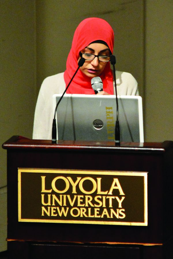 Rula Thabata, krewe leader and political science sophomore, presents the