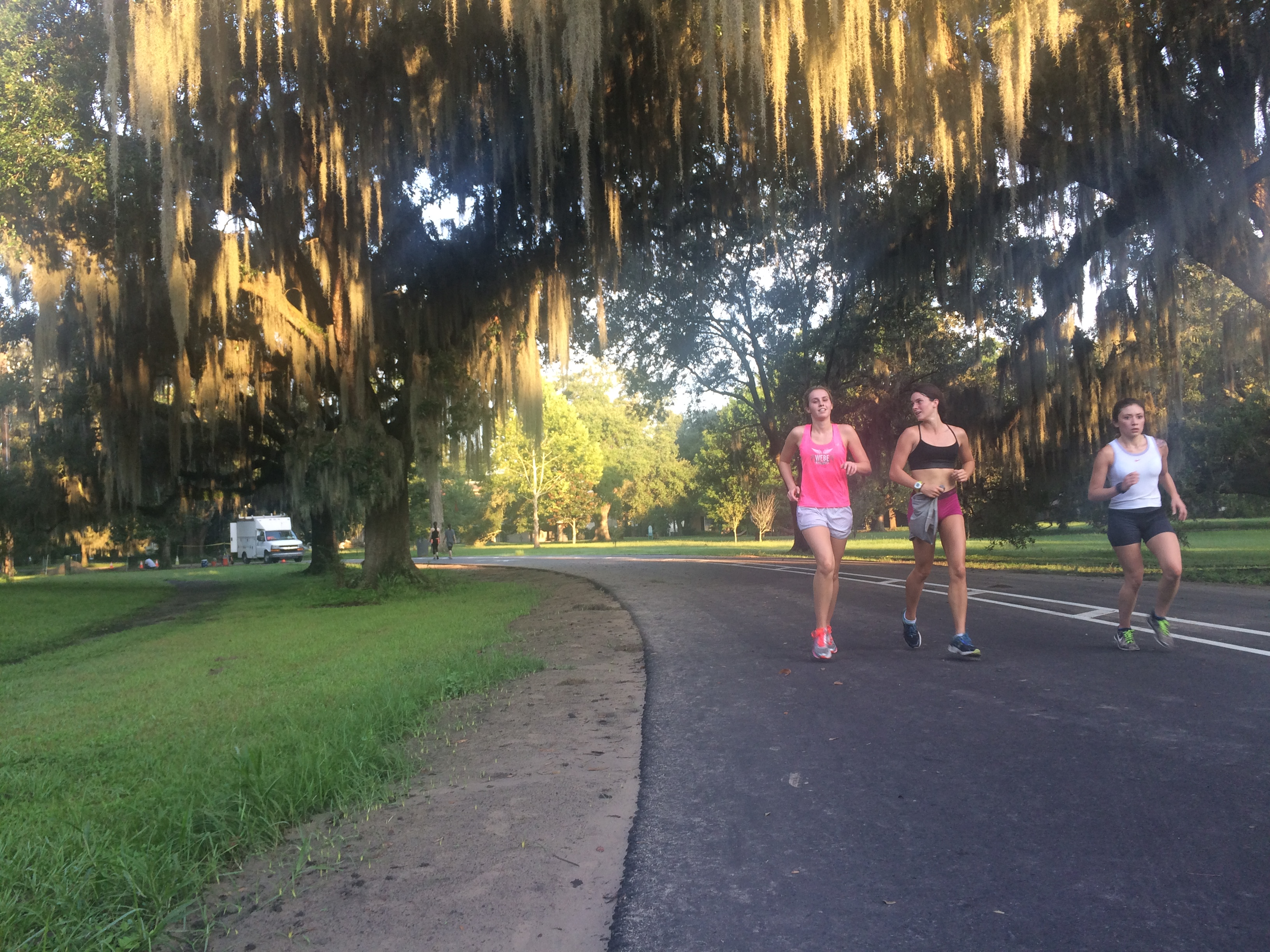 English sophomore Jordan Elissa, music freshman Tristin Sanders and biology sophomore Alma Guerra-Gonzalez run at cross country practice Aug. 24. The team has a new coach this year. Photo credit: Colleen Dulle
