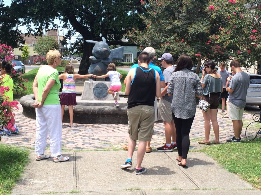Children approach the Pikachu statue in the Lower Garden District. The statue disappeared two weeks after it mysteriously appeared. Photo credit: Nick Reimann