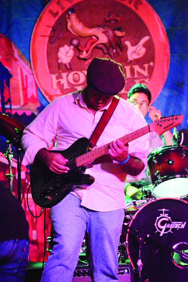 Marc Stone plays at The Howlin Wolf's benefit concert. Several bands performed at the concert to raise funds for flooding victims. The event raised around $3,000. Photo credit: Davis Walden