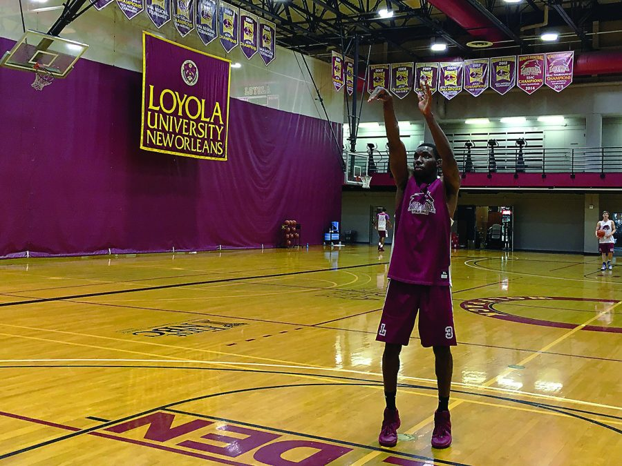 Johnny Griffin, Jr., management senior, shoots free throws at practice. Griffin took Loyola's basketball team by storm last year with his entertaining style of play. Photo credit: Kameron Hay