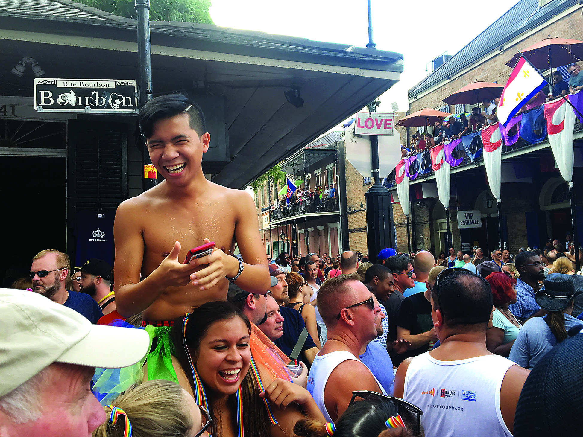 Calvin Tran, music therapy/pre-health sophomore and Samantha Menendez, psych/pre-health junior team up for a better view during the Southern Decadence Walking Parade Sunday afternoon. The weekend rain didn't stop huge crowds from celebrating. Photo credit: Molly Olwig