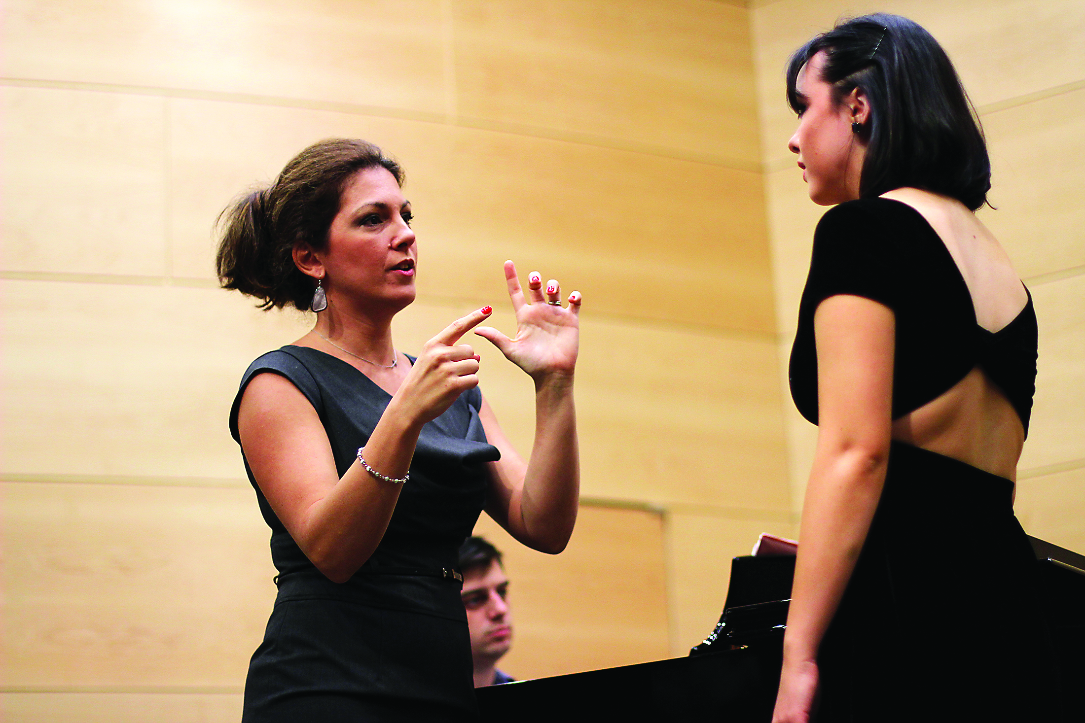 In her master class inside Nunemaker Hall, Irini Kyriakidou instructs vocal performance junior Emilie Tolley in performing her operatic arias. Kyriakidou covered how to arrive at more clear vocals to achieve a preciser sound. Photo credit: Tasja Demel