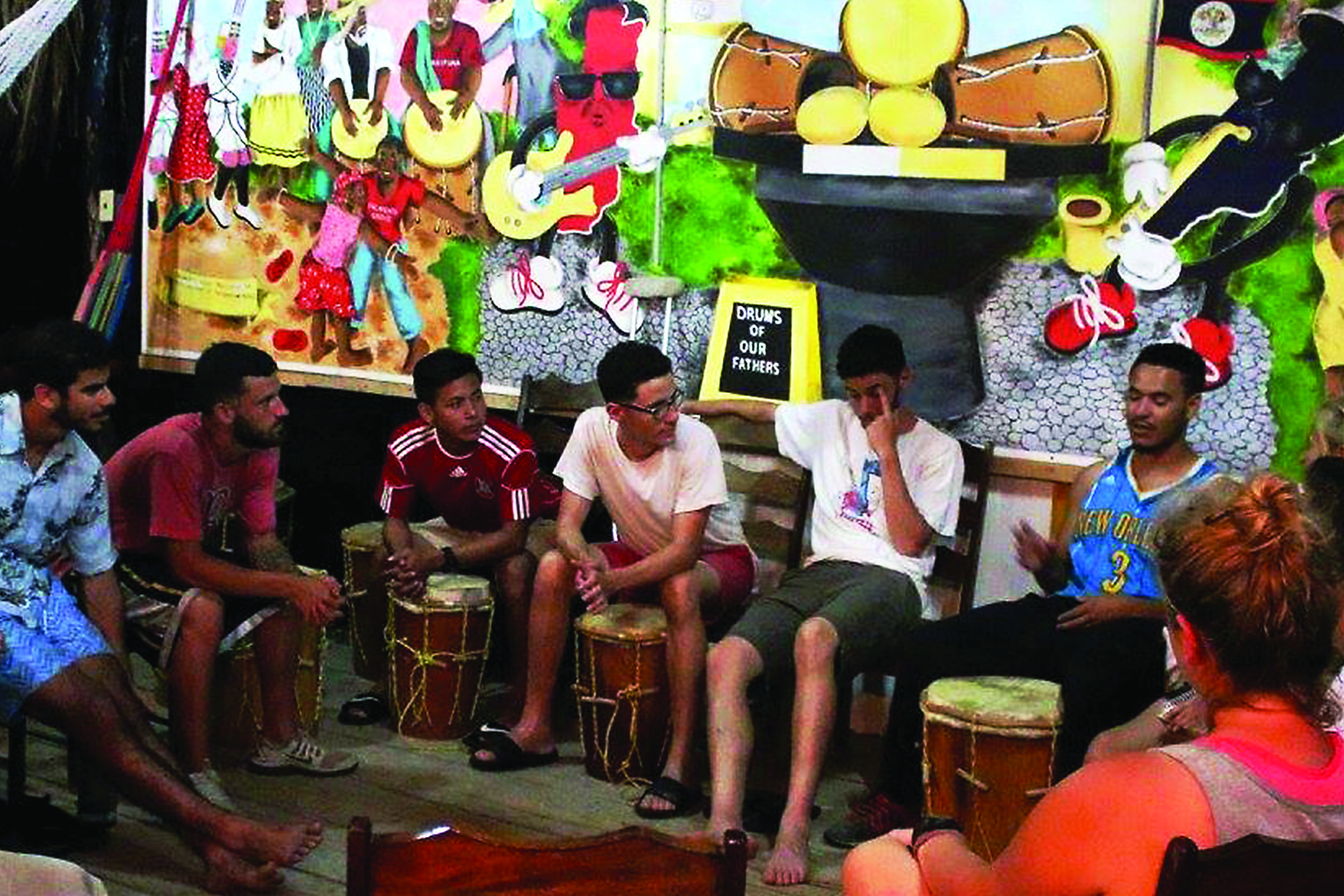 Loyola students and alumni teach drumming at a music program they established in Belize. The Belize trip was established because there were previously no university programs for music in the country. Photo credit: Courtesy of the Rev. Ted Dzak S.J.