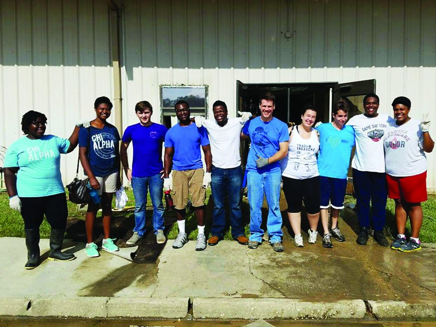 Chi Alpha students take a break from cleaning Faith Worship Center. The student group went to Baton Rouge to help clean up after the flooding. Photo credit: Alliciyia George