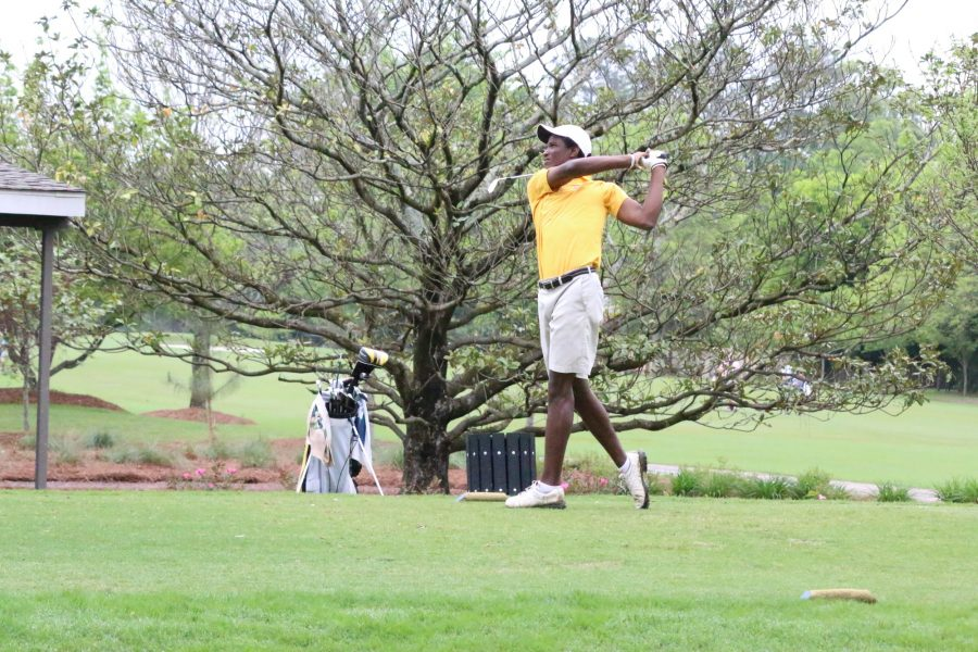 A Loyola golfer finishes his swing at a tournament in Audubon Park during the fall semester of 2015. The golf team is currently preparing for their first tournaments of the season.