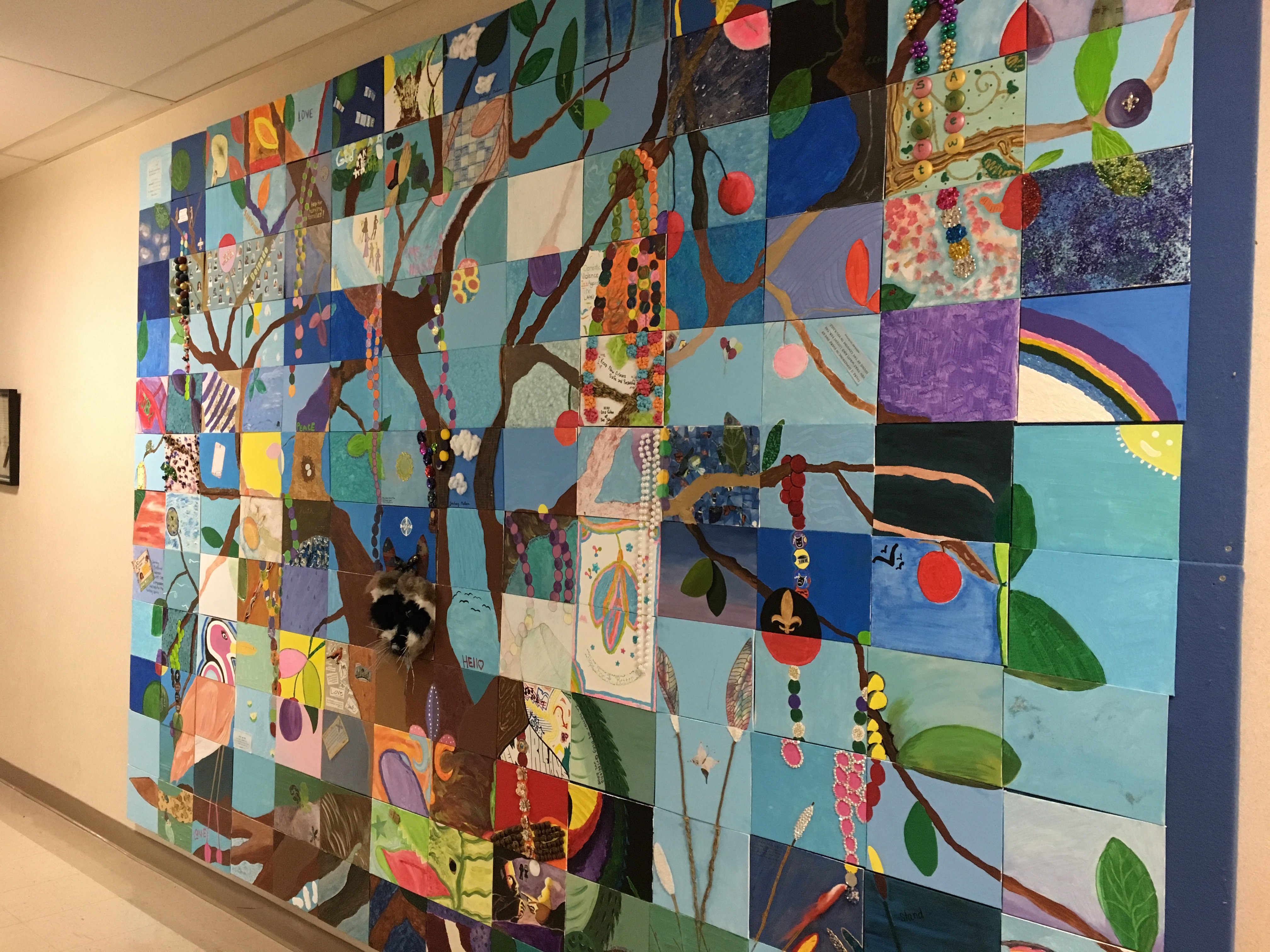 A quilt made by survivors of sexual assault hangs on the wall of the New Orleans Family Justice Center. Sexual assault remains one of the most underreported crimes. Photo credit: Lester Duhe