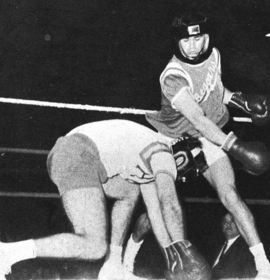 Wally Cowan, a Beggars brother, misses a right hand swipe at a fallen Curt Sins of Alpha Delta Gamma in the 1964 intramural boxing tournament between fraternities. The sororities at the time did no such thing. Photo credit: The Maroon