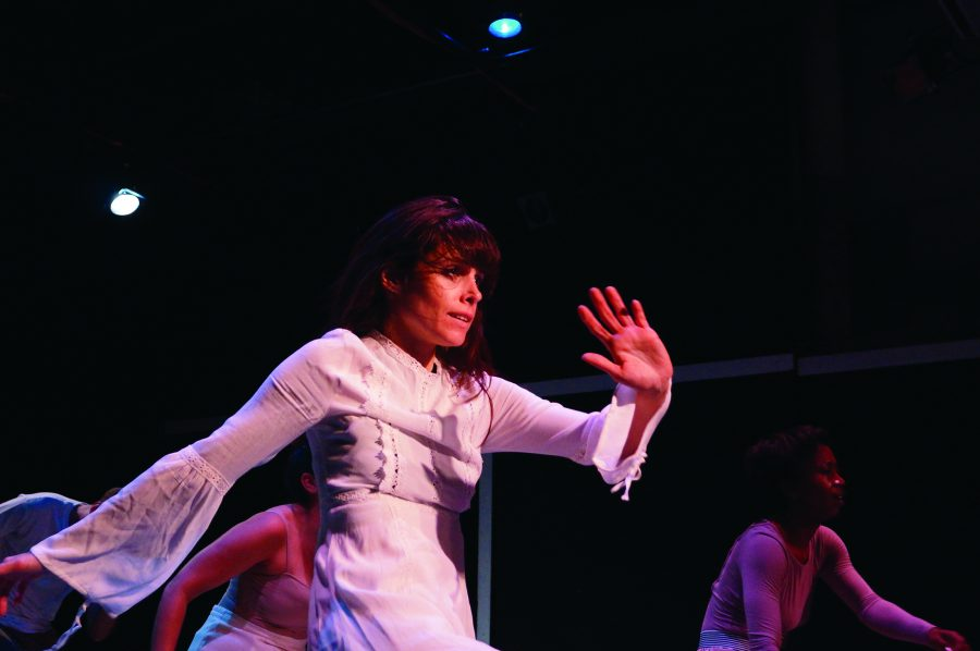 Monica+Ordonez%2C+artistic+director+of+Melange+Dance+Company%2C+performs+at+a+technical+rehearsal+of+%22Her+Story%22+on+Nov.+7.+%22Her+Story%22+uses+contemporary+dance+and+film+to+recount+women%27s+history+from+the+suffragist+movement+through+today.+Photo+credit%3A+Colleen+Dulle