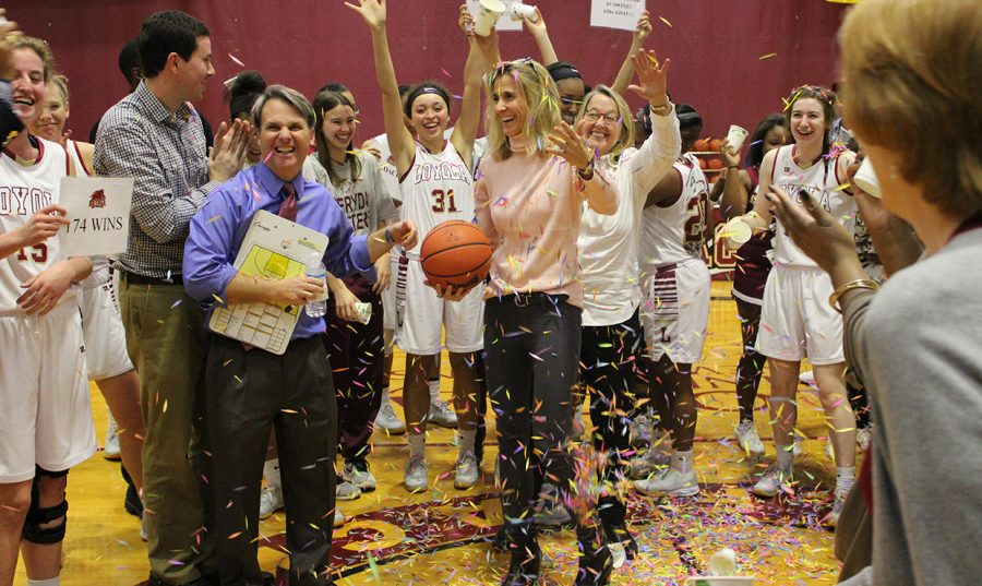 Cissy Petty, vice president for student affairs, throws confetti on Coack Kellie Kennedy after Monday's game, when Kennedy became the winningest coach in Loyola history. Photo credit: Loyola Athletics