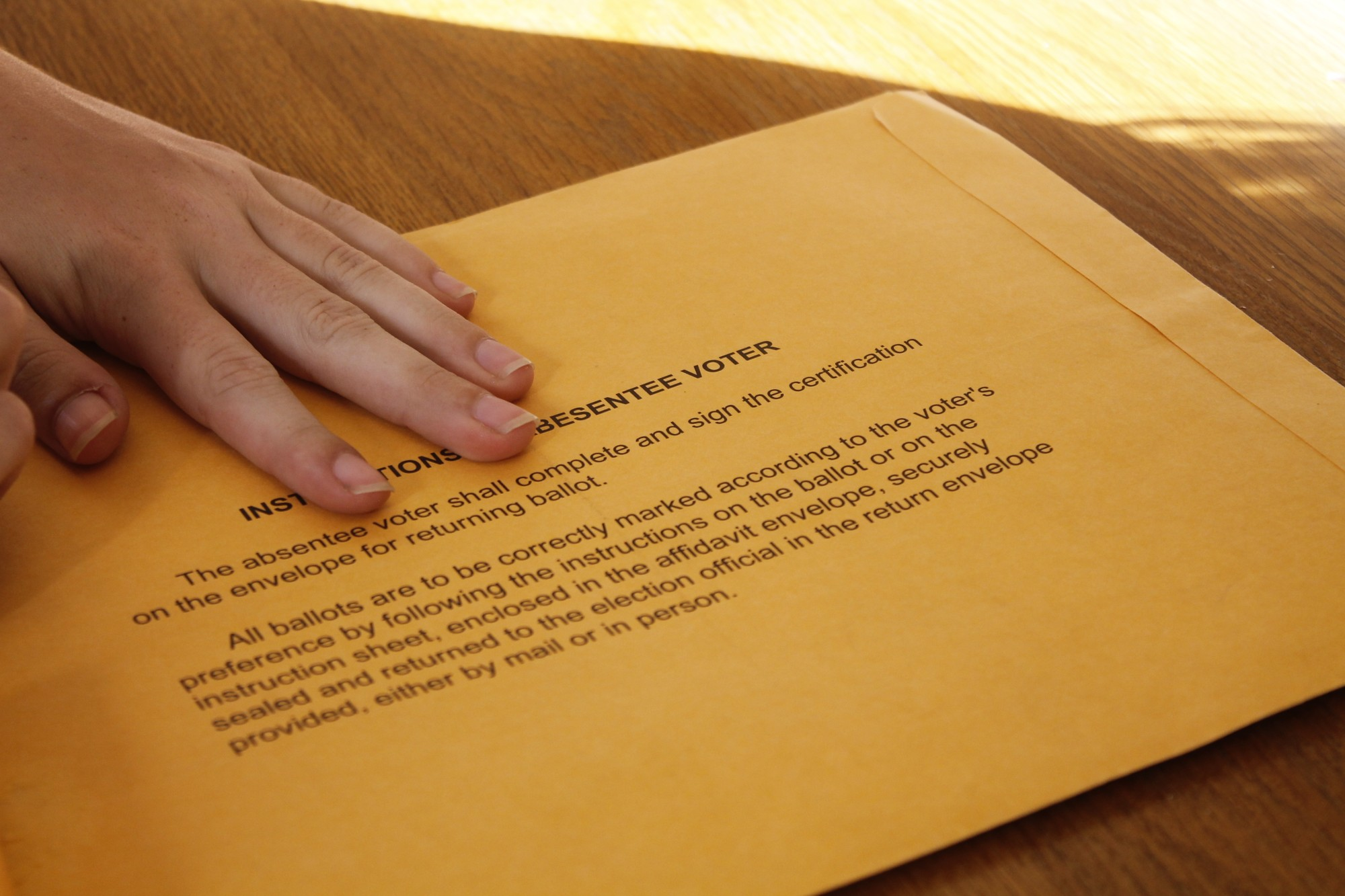 A Loyola student holds her absentee ballot envelope. Several students from Miami have not received their absentee ballots Nov. 7, the day before voting ends. Photo credit: Alliciyia George