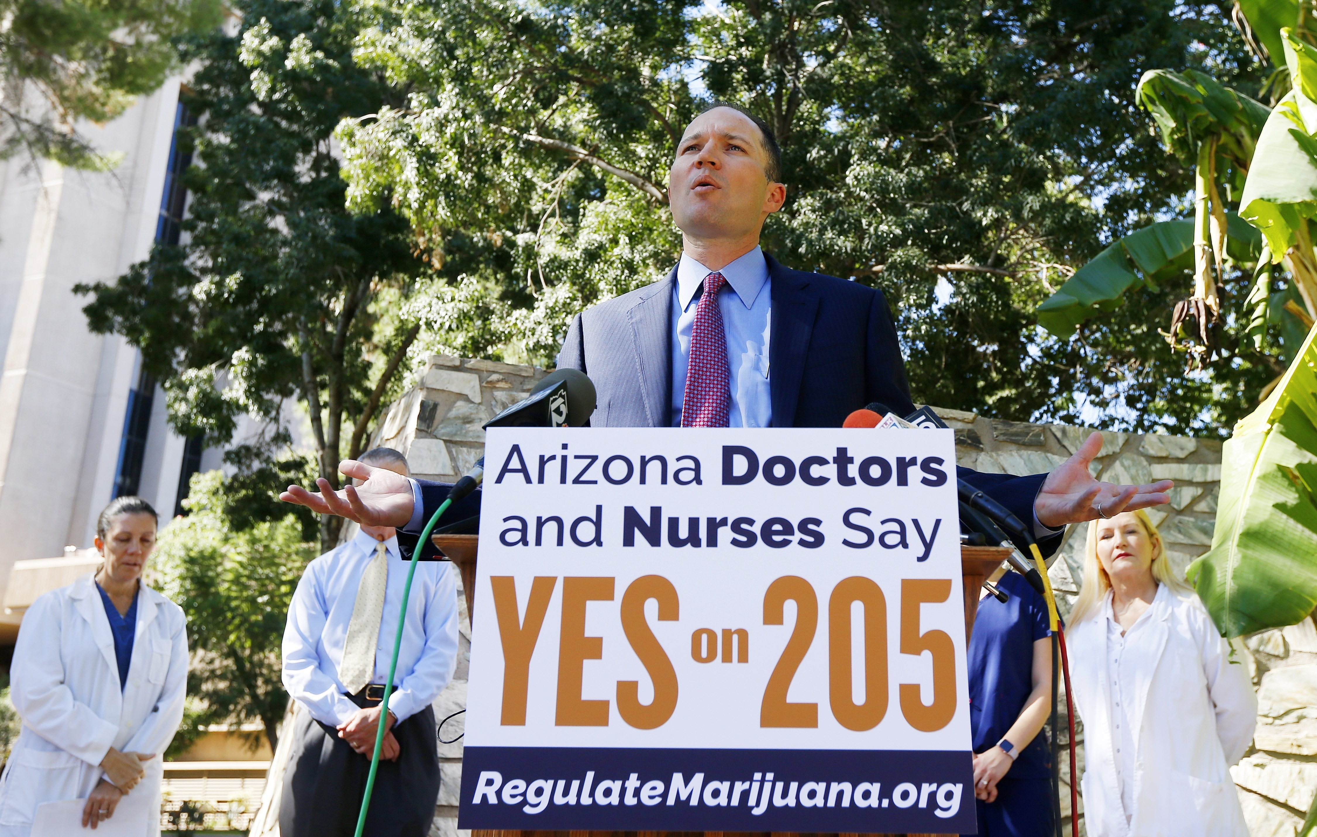 J.P. Holyoak, chair of the Campaign to Regulate Marijuana Like Alcohol, speaks at a news conference as he is joined by a host of doctors and nurses gather at the Arizona capitol to endorse Prop 205, the legalization of recreational marijuana, Wednesday, Oct. 26, 2016, in Phoenix. (AP Photo/Ross D. Franklin)