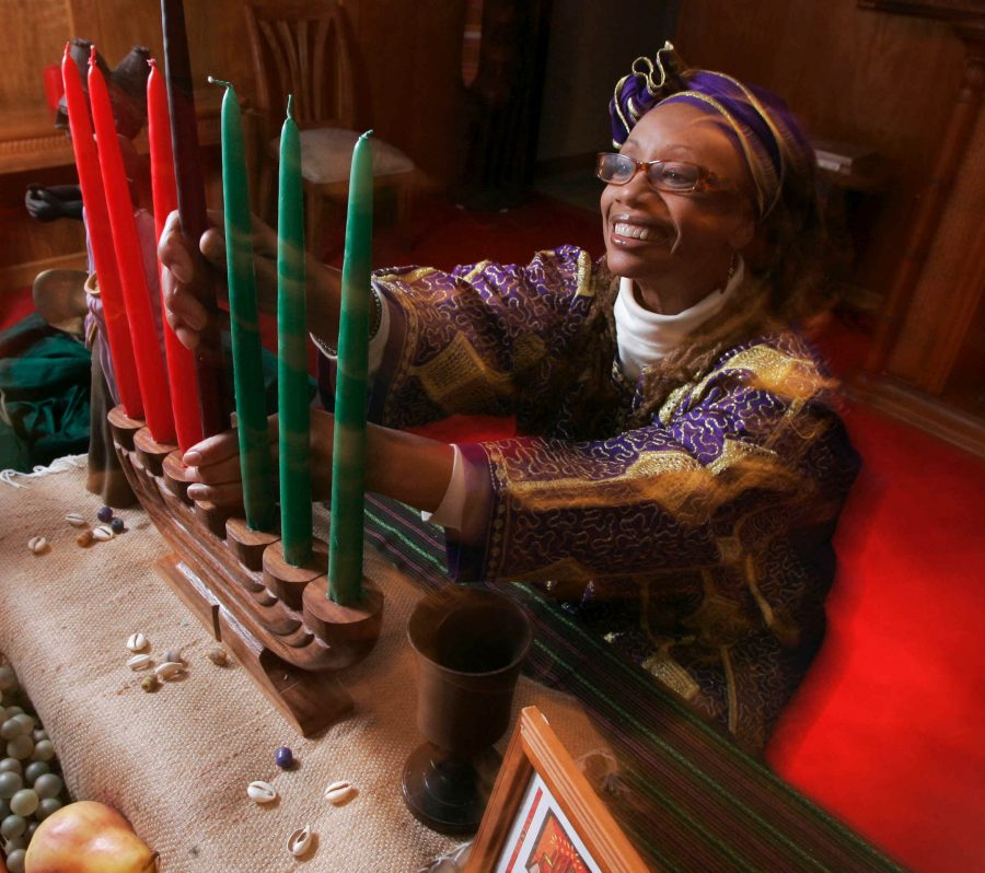 This photo taken Dec. 8, 2009 shows Ruth Ndiagne Dorsey with a Kwanzaa setting set up at her church, The Shrine of the Black Madonna, in Atlanta. (AP Photo/John Amis) Photo credit: Associated Press/John Amis