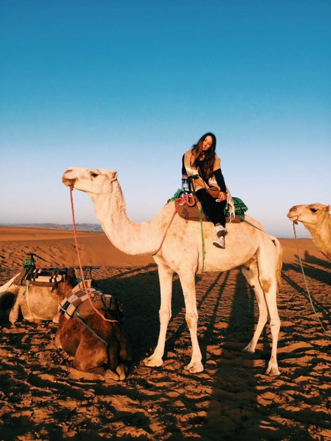 Francesca Bua, English junior, rides a camel in the Sahara Desert during a study abroad trip ealier this semester. Around 30 Loyola undergraduate students will study abroad this spring at 21 different universities across the globe. Photo credit: Francesca Bua