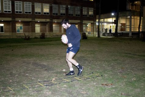 Vincent Duhe warms up in the Residential Quad. Loyola