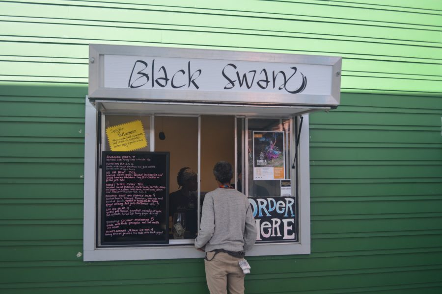 A customer orders food at Black Swan's restaurant location at Roux Carre. Photo credit: Davis Walden